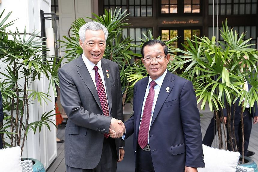 Prime Minister Lee Hsien Loong meeting Cambodian Prime Minister Hun Sen (left) and Thai Prime Minister Prayut Chan-o-cha (right) yesterday. He met Vietnam Prime Minister Nguyen Xuan Phuc on Saturday. PM Lee congratulated Mr Prayut on his election as
