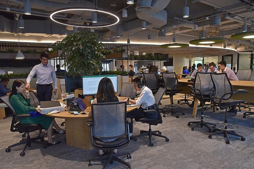 Real estate agency CBRE's new headquarters at Paya Lebar Quarter has various working spaces, such as (clockwise from above) the cafe and working area, a room which houses a state-of-the-art presentation tool called the Liquid Galaxy, and the team tot
