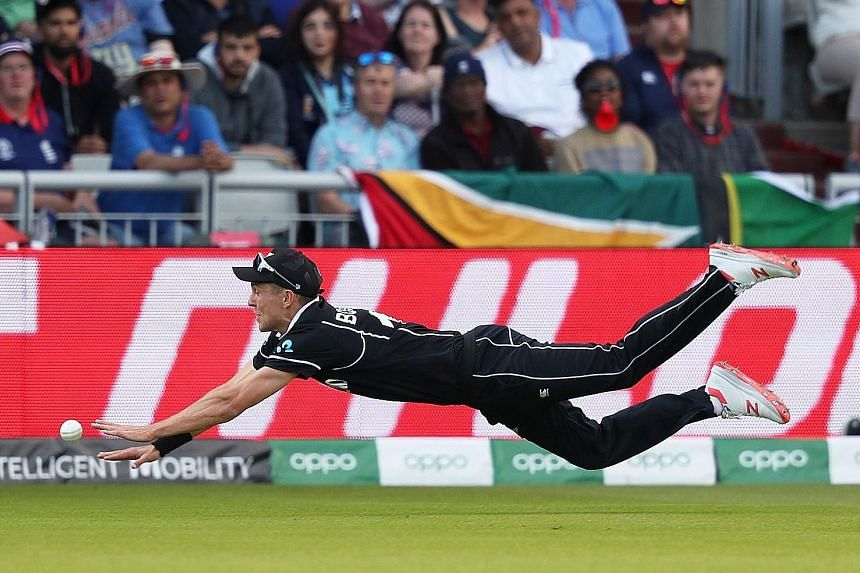 """New Zealand's Trent Boult diving to attempt a catch in Saturday's Cricket World Cup match against West Indies. Boult said fans back home would enjoy """"diving into their poached eggs"""" after the Kiwis snatched victory when West Indies had seemed headed"""