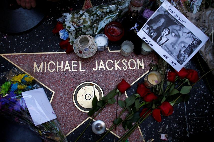 Michael Jackson's star on Hollywood's Walk of Fame continues to draw a constant scrum of selfie-snapping tourists.