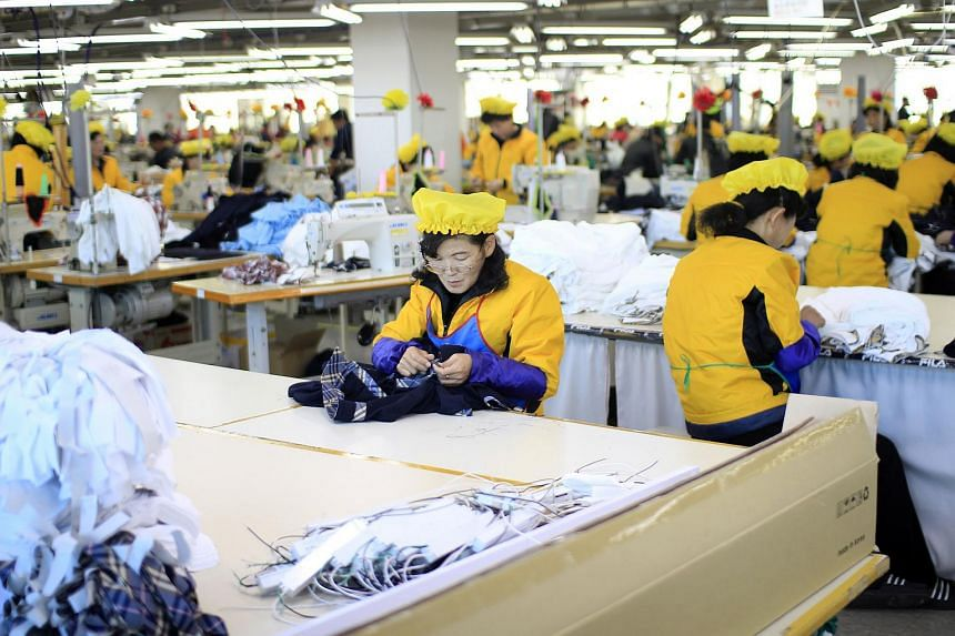 North Korean women working at a garment factory in the inter-Korean Kaesong Industrial Complex in 2015. About 55,000 of the North's workers churn out products for some 125 South Korean firms.
