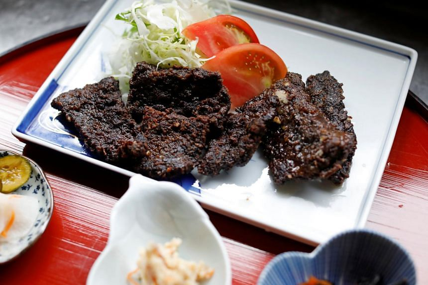 A set menu of pickle-grilled whale meat is prepared at the restaurant P-man in Minamiboso, Tokyo.