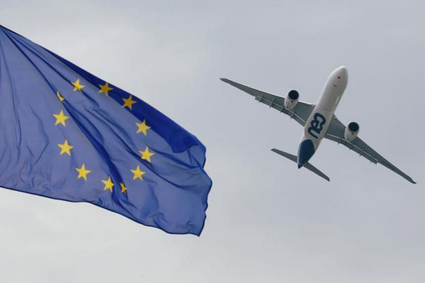 An Airbus A330neo flies over the European flag as it performs at the 53rd International Paris Air Show on June 23, 2019.