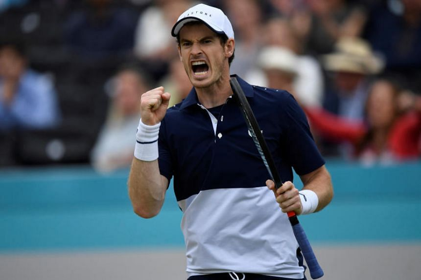 Britain's Andy Murray celebrates during his doubles final match against Rajeev Ram of the US and Britain's Joe Salisbury.