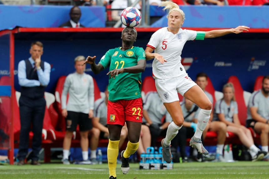 England's Steph Houghton in action with Cameroon's Michaela Abam.