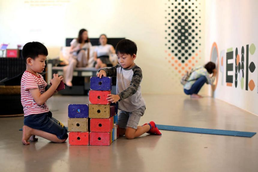 Eden Eyok (left) and Tan Hong Kai playing with wooden blocks at Playeum, a children's centre for creativity.