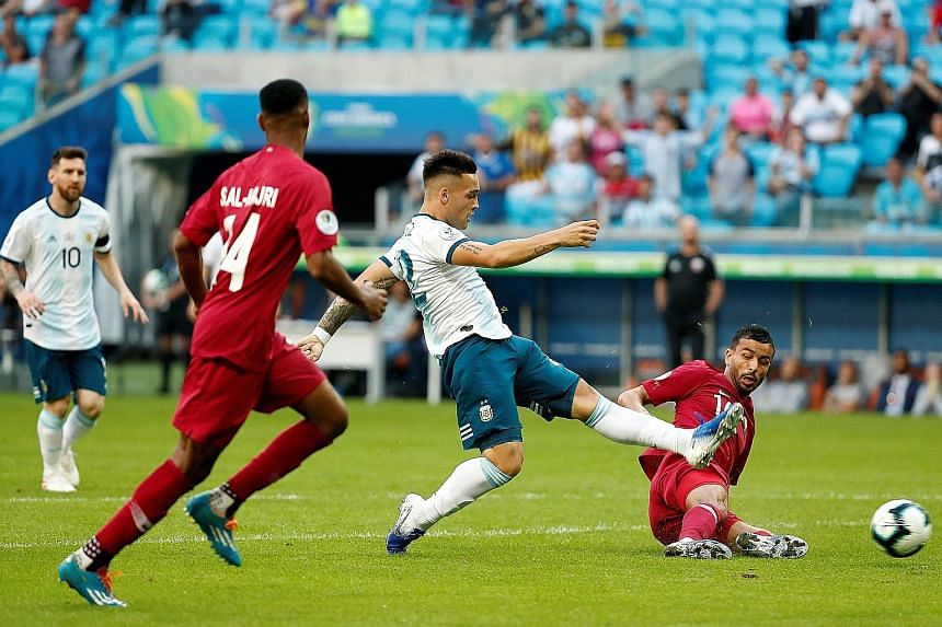 Forward Lautaro Martinez stabbing home Argentina's early opener in the fourth minute of their final Group B match against Qatar in Porto Alegre on Sunday. Argentina won 2-0 to reach the quarter-finals and will face Venezuela.