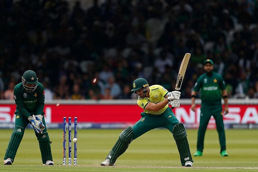 South Africa's Aiden Markram is bowled for just seven runs in the Cricket World Cup at Lord's on Sunday. The 49-run loss eliminated South Africa.