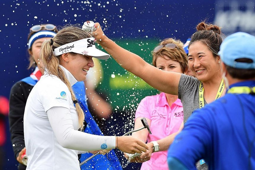 Hannah Green is drenched after the Australian edged out South Korean Park Sung-hyun by one stroke to win the Women's PGA Championship at Hazeltine National Golf Club on Sunday.