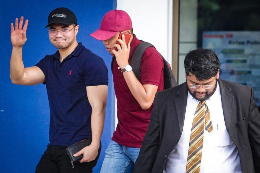 Haziq Aziz (left) leaving Dang Wangi District Police Headquarters in Kuala Lumpur, Malaysia.