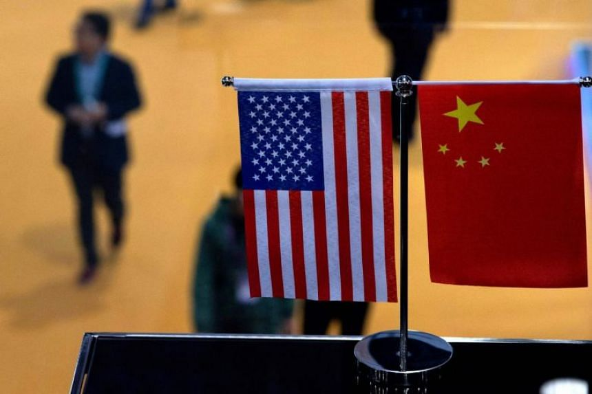 Chinese and US flags at a booth during an event in Shanghai.