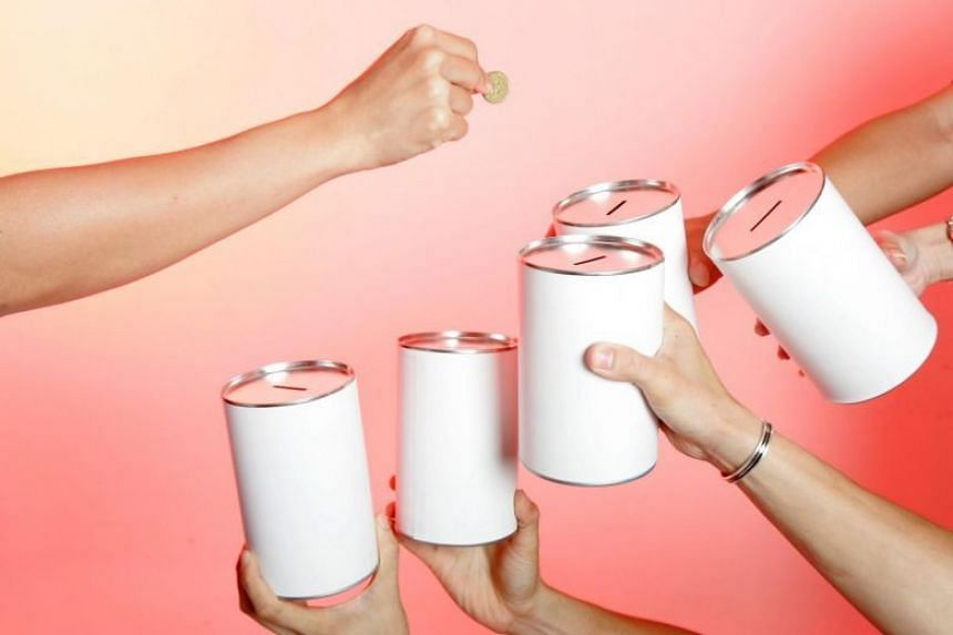 File photo of donation tin cans.