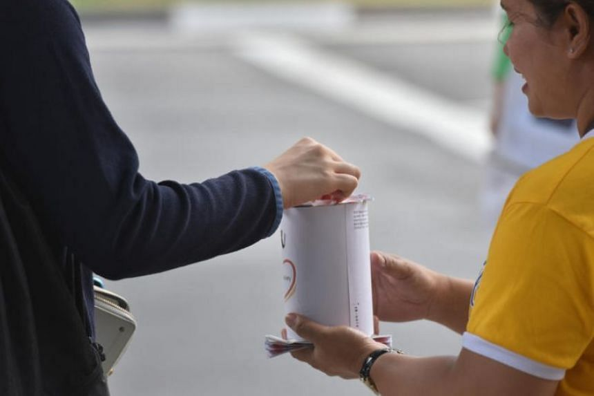 A person making a donation in Yishun.