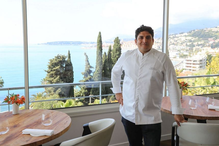 "Italian-Argentinian chef Mauro Colagreco poses for a photo in the ""Mirazur"" restaurant in the French riviera city of Menton on April 13, 2019."