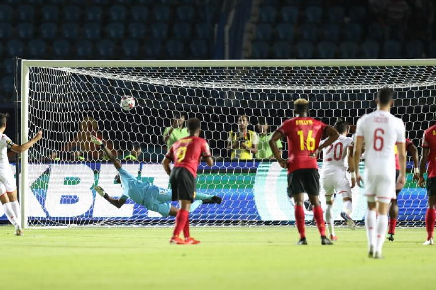 Tunisia's Youssef Msakni (left) scores a penalty during the 2019 Africa Cup of Nations Group E soccer match against Angola in Suez, Egypt, on June 24 2019.