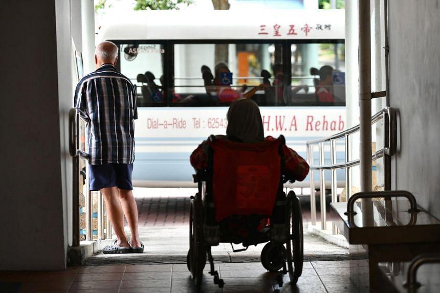 An elderly man and wheelchair-bound woman in Geylang Bahru.