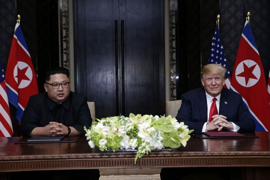US President Donald Trump and North Korean leader Kim Jong Un during their summit at Capella Singapore on June 12, 2018.