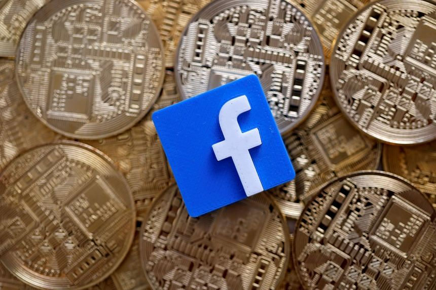 A 3D-printed Facebook logo on representations of the Bitcoin virtual currency. Facebook announced last week it planned to launch Libra next year, which is backed by a host of companies including Visa and PayPal.