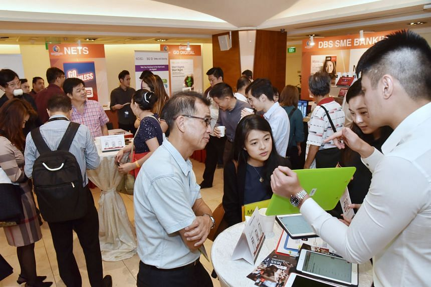 Participants networking at the Singapore Heartland Enterprise Seminar at Toa Payoh HDB Hub, where the official launch of the Heartland Enterprise Centre Singapore took place yesterday.