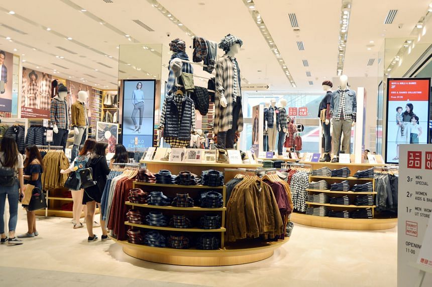 Fast Retailing CEO Tadashi Yanai (above) is considering offering higher pay to draw talented people. The company owns Uniqlo stores such as this outlet (left) in Orchard Road. ST FILE PHOTO
