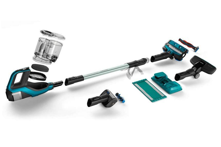 Philip's SpeedPro Max Aqua has a regular vacuum nozzle magnetically attached to the front of a rectangular mop module which has a small water tank on top.