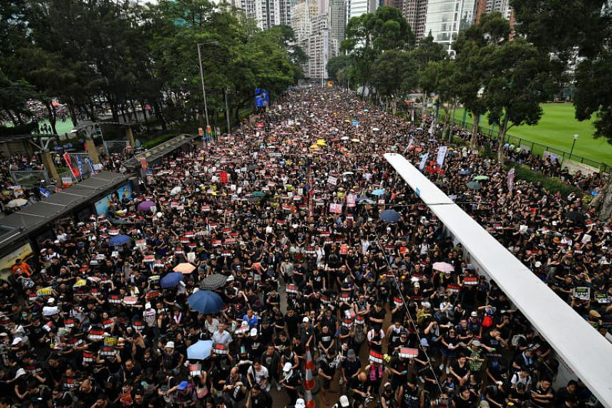 A view of protestors marching in Victoria Park on June 16, 2019. More than 22,000 people had raised HK$5.5 million within hours of the crowdfunding campaign's launch, exceeding a HK$3 million target.