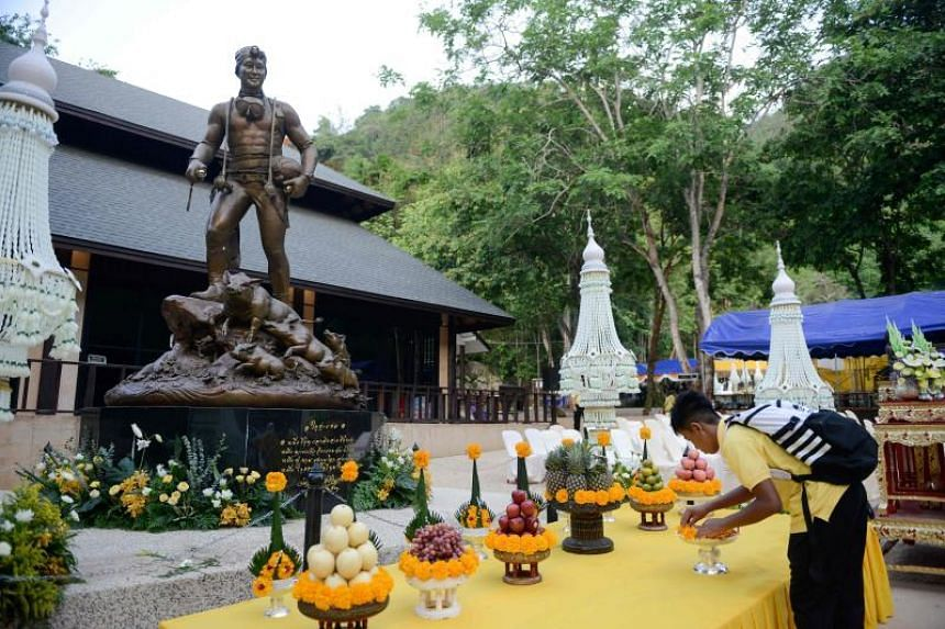 """The boys from """"Wild Boars"""" youth football team gave alms to Buddhist monks at a ceremony in Mr Saman Gunan's honour, also offering a feast to cave spirits."""
