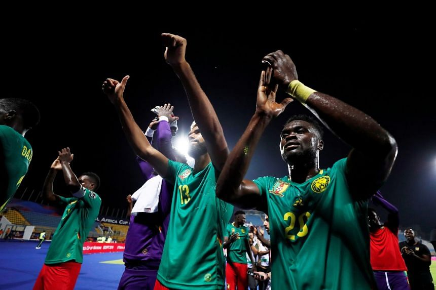 Cameroon's Eric Choupo-Moting and Olivier Boumal celebrate after the match.