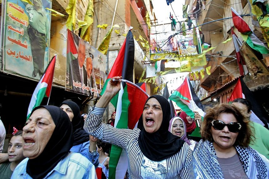 Palestinian women protesting in a refugee camp in Lebanon against the economic formula proposed by the United States for Israeli-Palestinian peace. PHOTO: DPA