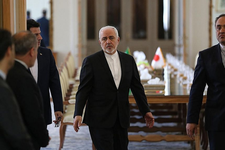 US sanctions have been imposed on Iran's Supreme Leader Ali Khamenei (top), and Foreign Minister Javad Zarif (above) is expected to be blacklisted later this week. Iranian President Hassan Rouhani described the moves by Washington as desperate.