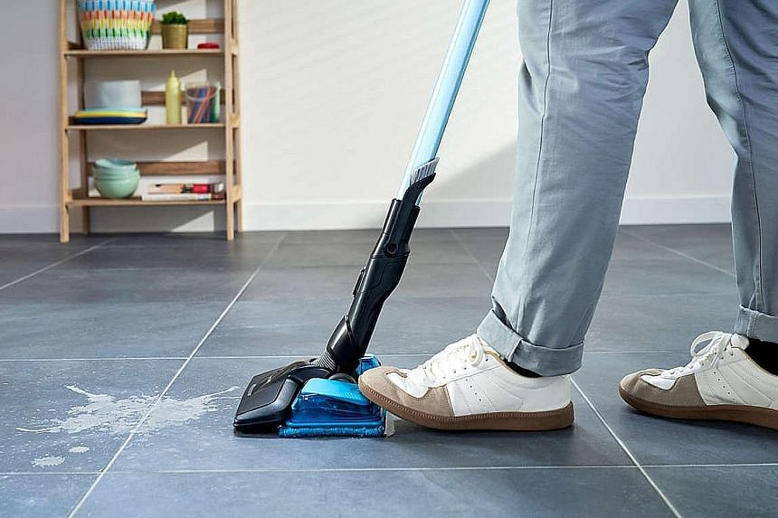 The SpeedPro Max Aqua has a vacuum-and-mop nozzle that sucks up dust, then mops the just-vacuumed area in the same action. There is a pedal to control water release while mopping.