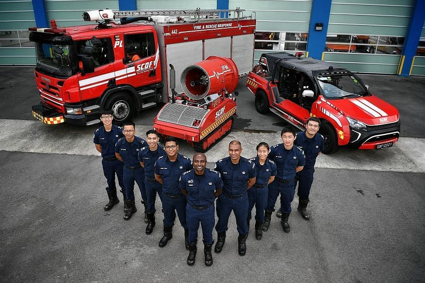 Among the firefighters who tackled last Friday's blaze at a Jalan Buroh liquefied petroleum gas facility were (from left) Corporal Thio Zheng Yang, Lance Corporal Muhammad Fazlan Rozali, Sergeant Ahmad Kafee Azman, Second Warrant Officer Syed Yazid S
