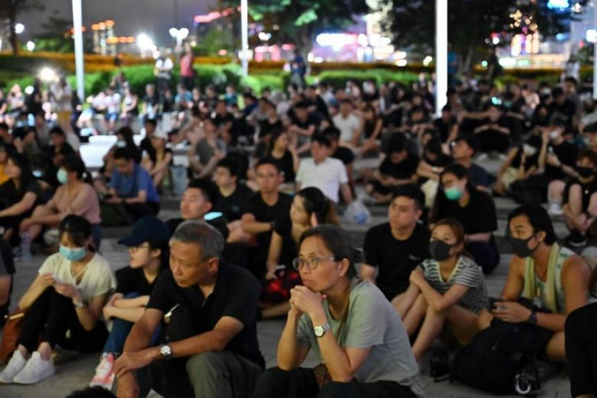 People gather outside of the Legislative Council building to protest in Hong Kong, on June 23, 2019.