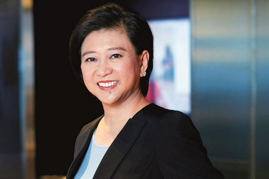 "Singtel group chief executive Chua Sock Koong's salary was nearly halved, after she oversaw what she said was ""far from business as usual""."
