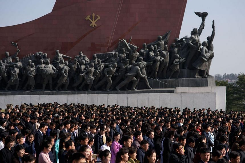 People leave after paying their respects before the statues of late North Korean leaders Kim Il Sung and Kim Jong Il on Mansu hill in Pyongyang, on April 15, 2019.