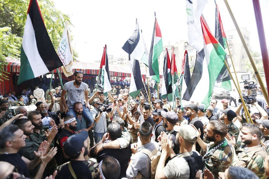 Syrians and Palestinians protesting yesterday, at the Palestinian Yarmouk Camp in Damascus, against the $68 billion economic formula proposed by the US for Israeli-Palestinian peace. Washington was to launch its plan in Bahrain yesterday but the Pale