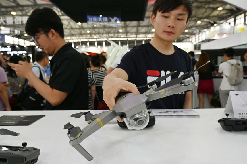 A DJI drone on display at the Consumer Electronics Show, Ces Asia 2019, in Shanghai earlier this month. DJI, a privately-held Chinese firm says it is repurposing a warehouse in California to assemble a new version of a drone popular among US governme