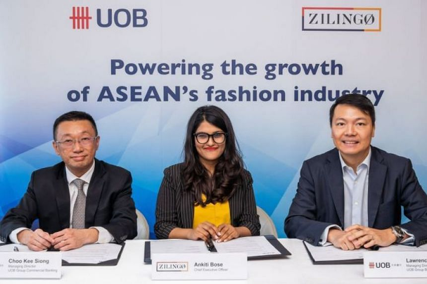 (From left) Mr Choo Kee Siong, Head of Industry Groups, Group Commercial Banking, UOB, Ms Ankiti Bose, CEO and co-founder, Zilingo and Mr Lawrence Loh, Head of Group Business Banking, UOB, signing an MOU to help drive the growth of Asean's fashion