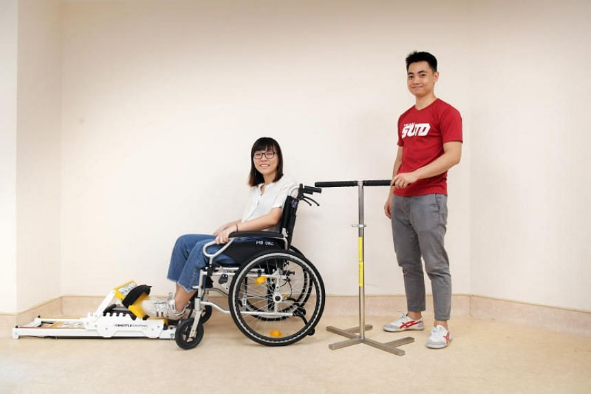 Singapore University of Technology and Design students Lu Wan Yun and Ivan Tang demonstrate the Maeum, a redesigned wheelchair stabiliser.