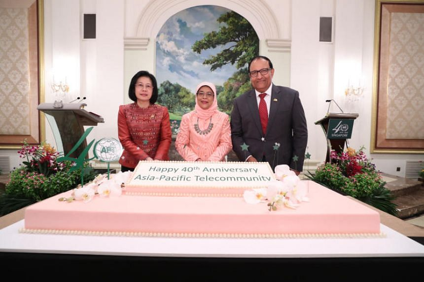 (From left) Asia-Pacific Telecommunity (APT) secretary-general Areewan Haorangsi, President Halimah Yacob and Communications and Information Minister S. Iswaran at APT's 40th anniversary celebrations.