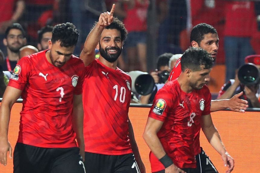 Egypt's Mohamed Salah (second left) celebrates with  team mates after scoring the 2-0 lead.