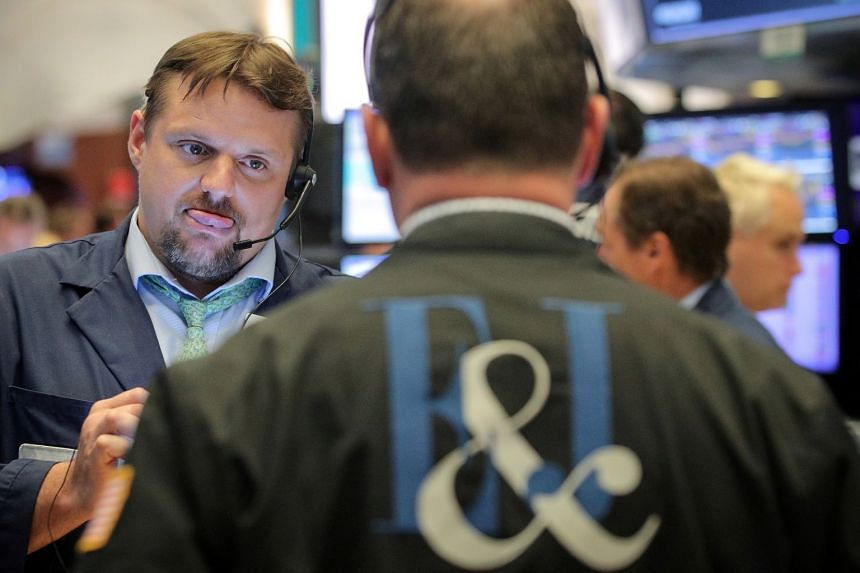 Traders work on the floor at the New York Stock Exchange in a file photo.