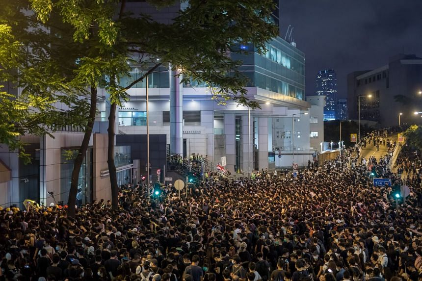 Demonstrators gather at the entrance of the police headquarters during a protest in Hong Kong.