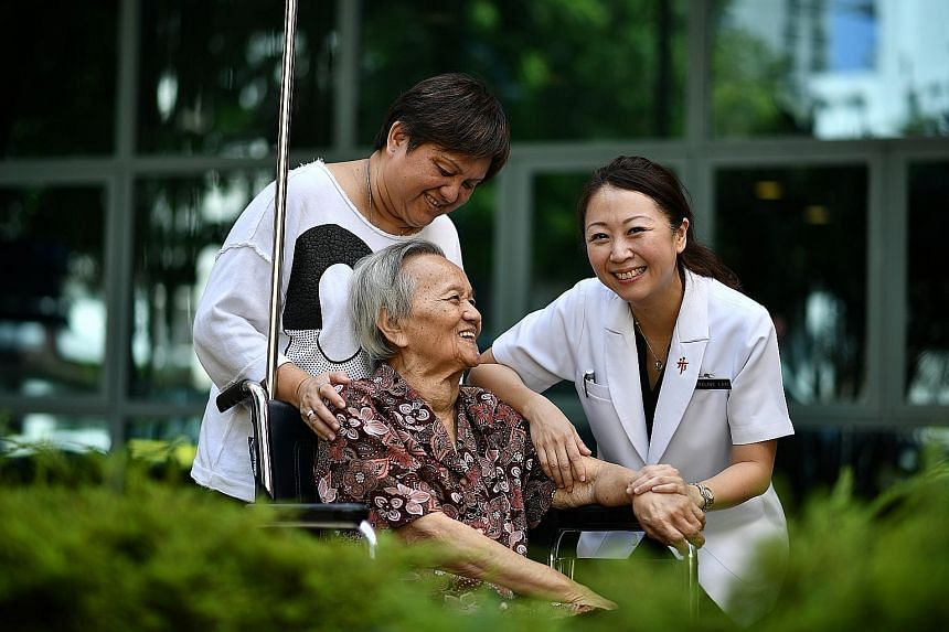 Madam Wee Ah Miow, with her daughter Annie Lim (left) and Dr Adeline Lam, made plans for her future care in 2017 after the new advance care planning system at Tan Tock Seng Hospital was up and running.