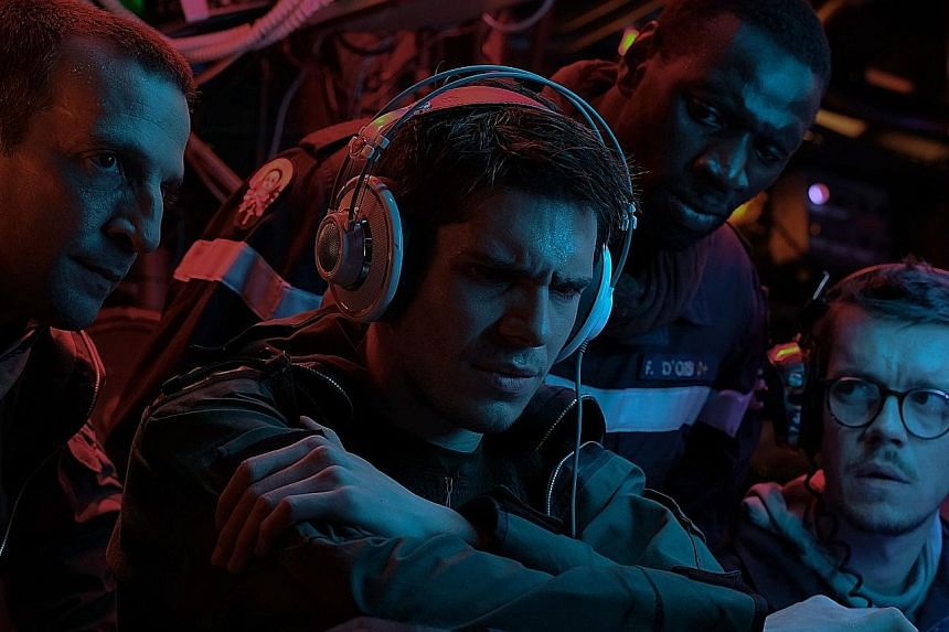 Francois Civil (second from far left) stars in The Wolf's Call as a submarine sonar technician with the superhuman ability to identify objects from the sounds they make in the water.