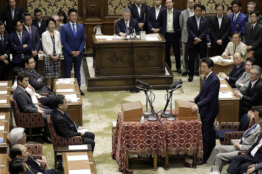 Japanese Prime Minister Shinzo Abe speaking during a party leaders' debate last week at the Lower House of Parliament in Tokyo. Mr Abe's Liberal Democratic Party is expected to keep its majority in the coming election, though possibly with reduced nu