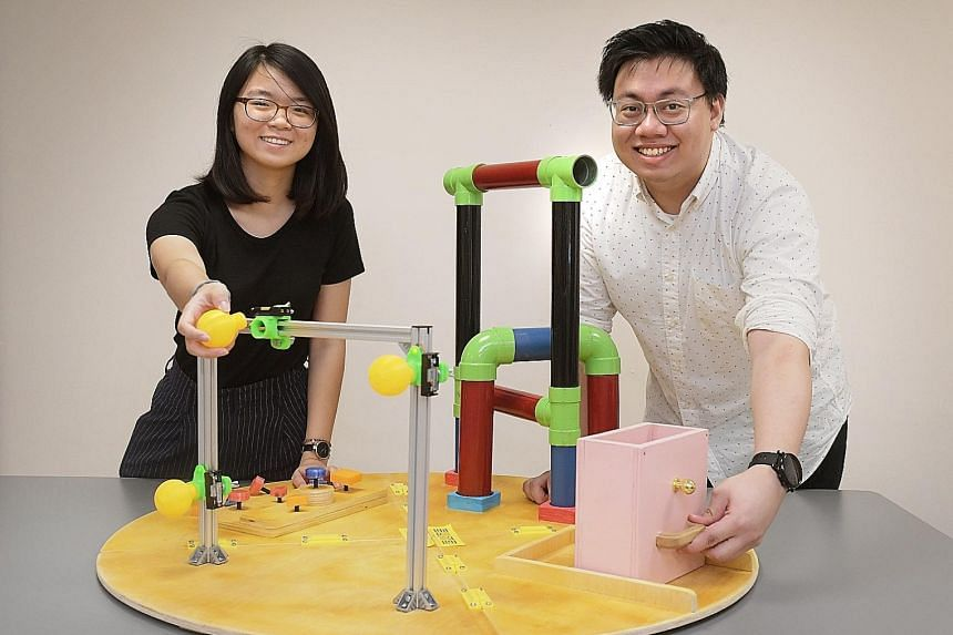 Singapore University of Technology and Design students Vanessa Poh, 21, and Clement Chen, 27, with their Joymaker project.