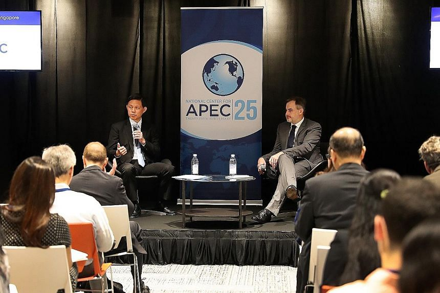 Minister for Trade and Industry Chan Chun Sing speaking at the National Centre for Asia-Pacific Economic Cooperation Executive Forum yesterday. With him is moderator Antony Cook, associate general counsel at Microsoft. Mr Chan said that as firms take