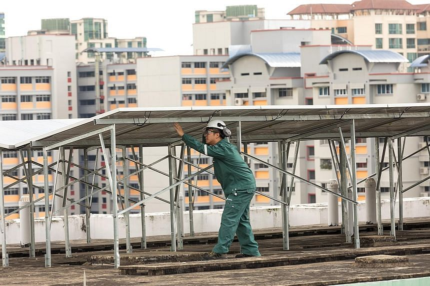 Rooftops offer potential for various applications. For instance, in Choa Chu Kang (left), Sembcorp Solar has installed solar panels on the roofs of HDB blocks. Meanwhile, vertical farms such as Sky Greens (right) optimise the use of their plots by gr