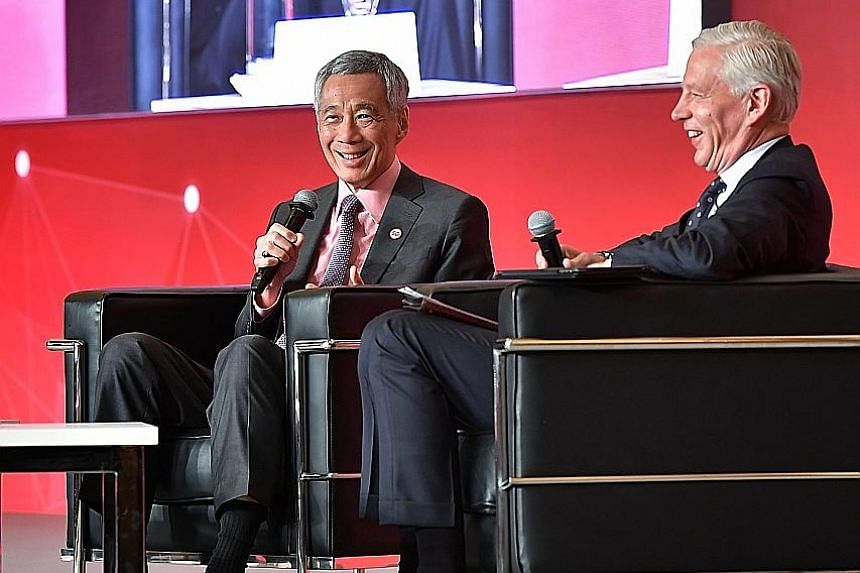 Prime Minister Lee Hsien Loong participating in a dialogue at yesterday's Smart Nation Summit, with moderator Dominic Barton, global managing partner emeritus at McKinsey & Co. In his speech earlier in the day, PM Lee said that while Singapore has a